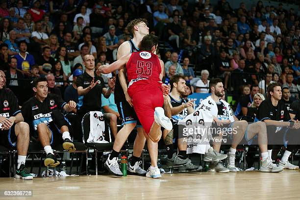 Damian Martin of the Wildcats clashes into Finn Delany and the Breakers' bench after saving a ball in play during the round 16 NBL match between the...