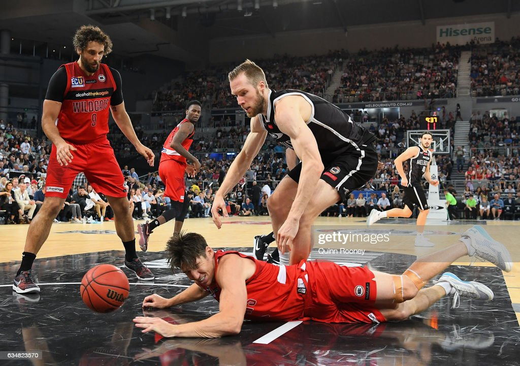 Damian Martin of the Wildcats dives for a ball during the round 19 NBL match between Melbourne United and the Perth Wildcats at Hisense Arena on February 12, 2017 in Melbourne, Australia.