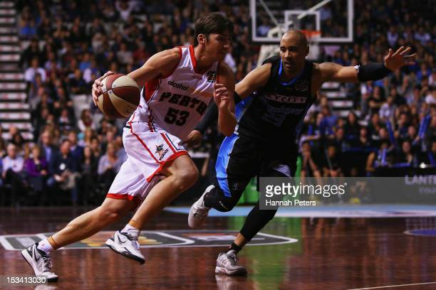 Damian Martin of the Wildcats gets around CJ Bruton of the Breakers during the round one NBL match between the New Zealand Breakers and the Perth...