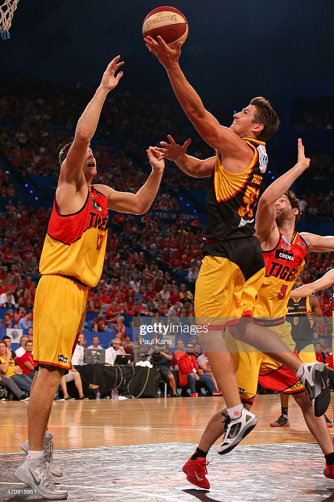 Damian Martin of the Wildcats lays up during the round 19 NBL match between the Perth Wildcats and the Melbourne Tigers at Perth Arena on February 21, 2014 in Perth, Australia.