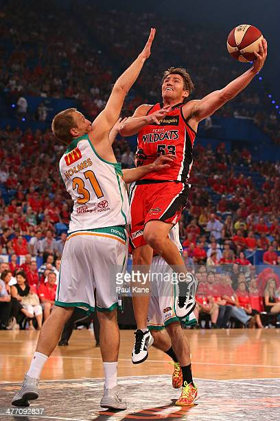 Damian Martin of the Wildcats laysup against Jacob Holmes of the Crocodiles during the round 21 NBL match between the Perth Wildcats and the...