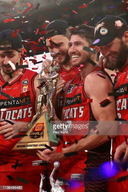 Damian Martin of the Wildcats looks on holding the championship trophy after winning the series during game 4 of the NBL Grand Final Series between...