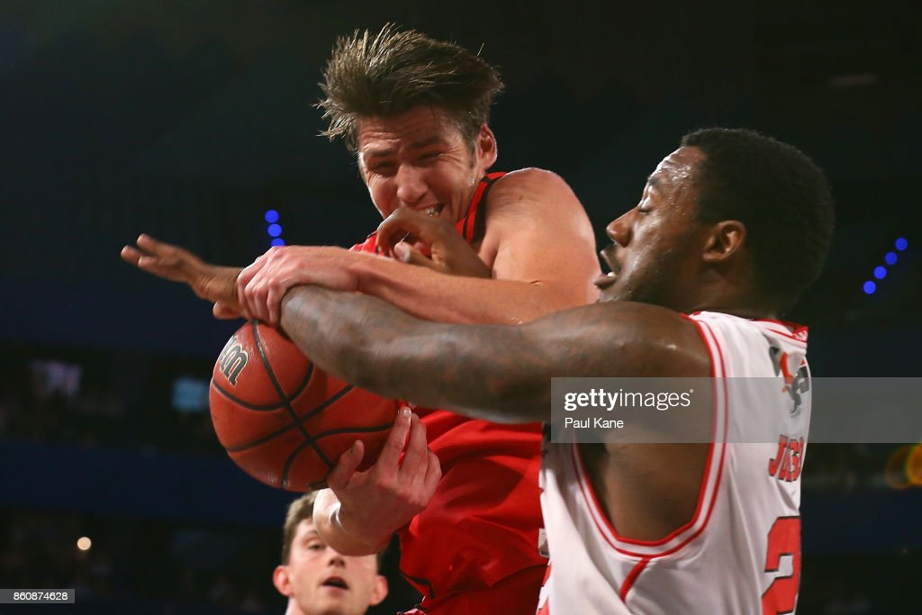 Damian Martin of the Wildcats pulls down a rebound against Delvon Johnson of the Hawks during the round two NBL match between the Perth Wildcats and the Illawarra Hawks at Perth Arena on October 13, 2017 in Perth, Australia.