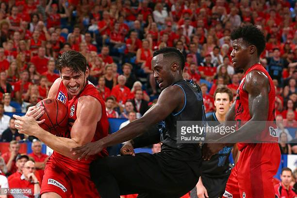 Damian Martin of the Wildcats strips the ball from Cedric Jackson of the Breakers during game one of the NBL Grand FInal series between the Perth...