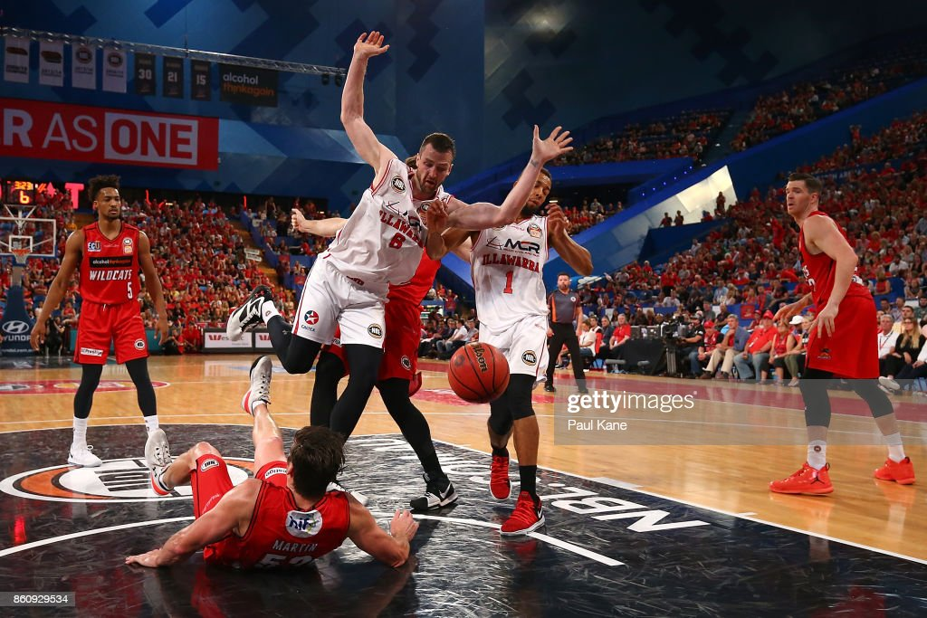 Damian Martin of the Wildcats takes the charge from Andrew Ogilvy of the Hawks during the round two NBL match between the Perth Wildcats and the Illawarra Hawks at Perth Arena on October 13, 2017 in Perth, Australia.