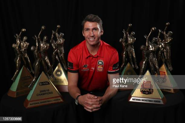 Damian Martin poses with his six NBL Championship trophies after announcing his retirement during a Perth Wildcats NBL media opportunity at the...