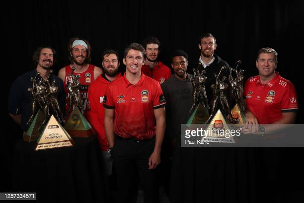 Damian Martin poses with his six NBL Championship trophies together with Greg Hire, Jesse Wagstaff, Mitchell Norton, Clint Steindl, Bryce Cotton,...