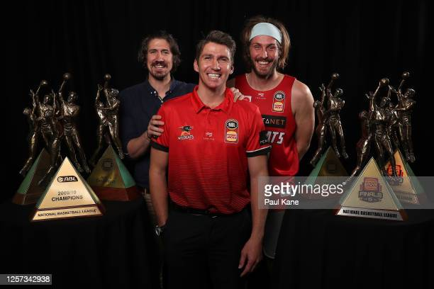 Damian Martin poses with his six NBL Championship trophies together with Greg Hire and Jesse Wagstaff after announcing his retirement during a Perth...