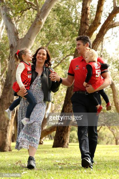 Damian Martin shares a moment with his wife Brittany and daughters Maggie and Bonnie after announcing his retirement during a Perth Wildcats NBL...