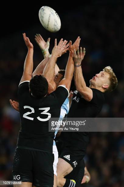 Damian McKenzie and Anton LienertBrown of the All Blacks competes for a high ball against Emiliano Boffelli of Argentina during The Rugby...