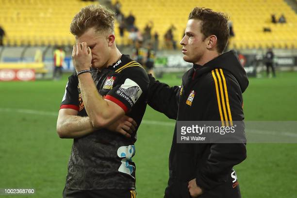 Damian McKenzie and Brad Weber of the Chiefs look dejected following the Super Rugby Qualifying Final match between the Hurricanes and the Chiefs at...
