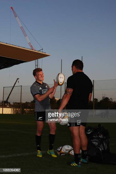 Damian McKenzie and Codie Taylor chat after a New Zealand All Blacks training session on October 25 2018 in Tokyo Japan