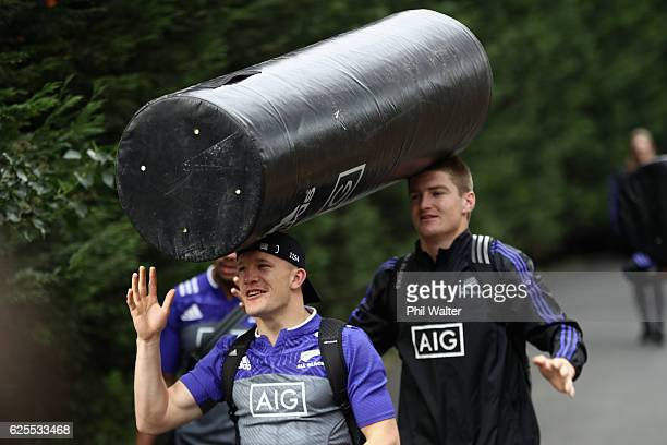 Damian McKenzie and Jordie Barrett of the New Zealand All Blacks arrive for a training session with the tackle bags at the Suresnois Rugby Club on...