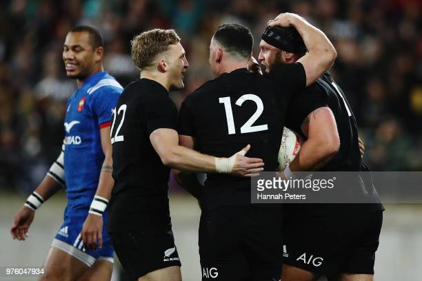 Damian McKenzie and Ryan Crotty of the All Blacks celebrate after Joe Moody of the All Blacks scored a try during the International Test match...