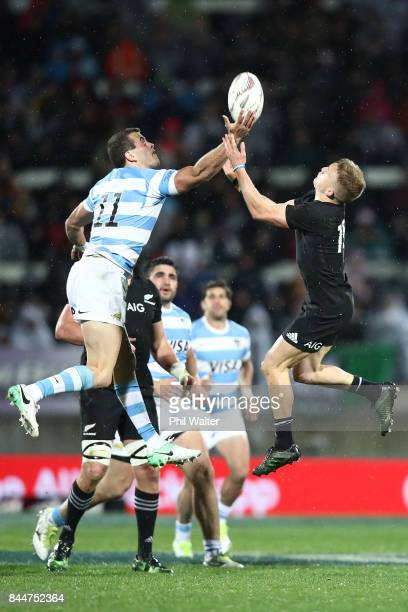 Damian McKenzie of the All Blacks and Emiliano Boffelli of Argentina contest the high ball during The Rugby Championship match between the New...