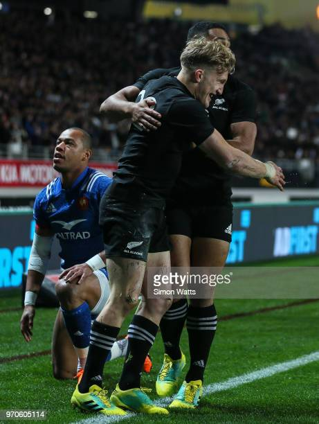 Damian McKenzie of the All Blacks celebrates a try during the International Test match between the New Zealand All Blacks and France at Eden Park on...