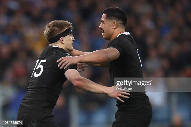 Damian McKenzie of the All Blacks celebrates his try with Anton LienertBrown during the International Rugby match between the New Zealand All Blacks...