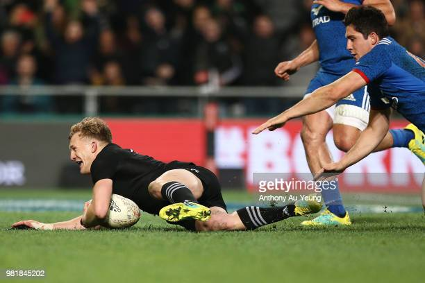 Damian McKenzie of the All Blacks dives over to socre a try during the International Test match between the New Zealand All Blacks and France at...