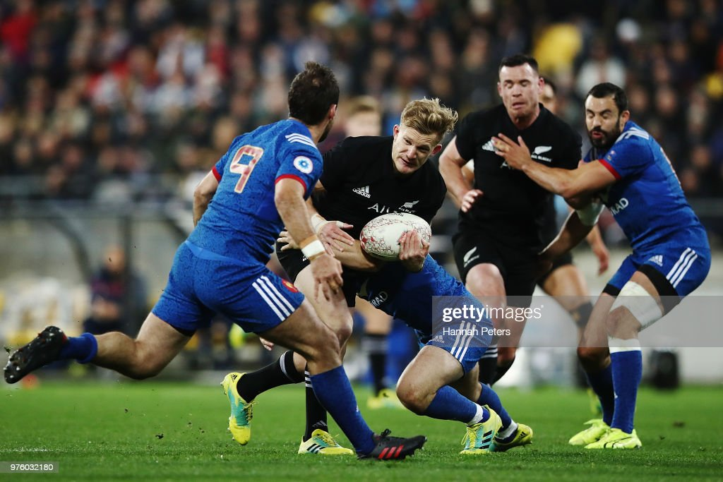 Damian McKenzie of the All Blacks makes a break during the International Test match between the New Zealand All Blacks and France at Westpac Stadium on June 16, 2018 in Wellington, New Zealand.