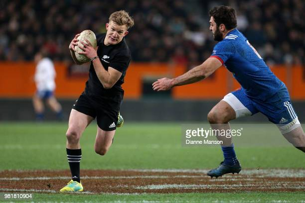Damian McKenzie of the All Blacks makes a break during the International Test match between the New Zealand All Blacks and France at Forsyth Barr...