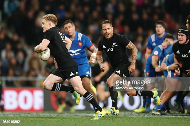 Damian McKenzie of the All Blacks makes a break to score a try during the International Test match between the New Zealand All Blacks and France at...