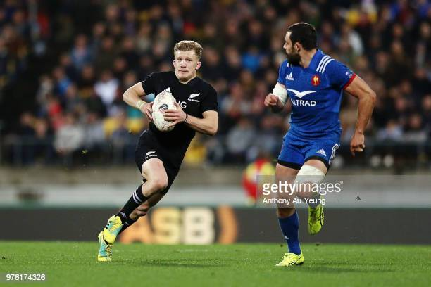 Damian McKenzie of the All Blacks makes a run during the International Test match between the New Zealand All Blacks and France at Westpac Stadium on...