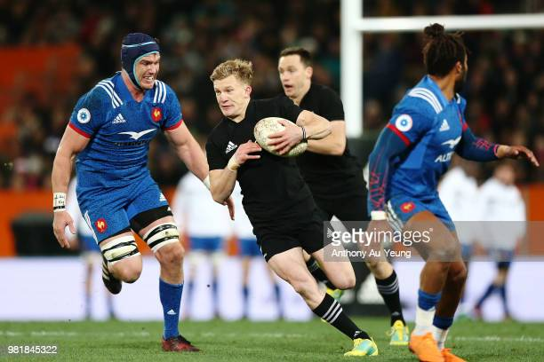 Damian McKenzie of the All Blacks makes a run during the International Test match between the New Zealand All Blacks and France at Forsyth Barr...