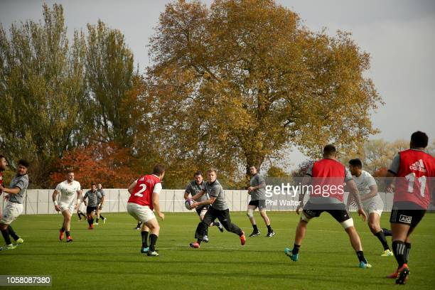 Damian McKenzie of the All Blacks passes during a New Zealand All Blacks training session at The Lensbury on November 6 2018 in London England