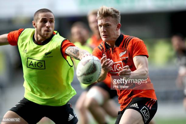 Damian McKenzie of the All Blacks passes the ball in the lineout during a New Zealand All Blacks training session at Forsyth Barr stadium on August...