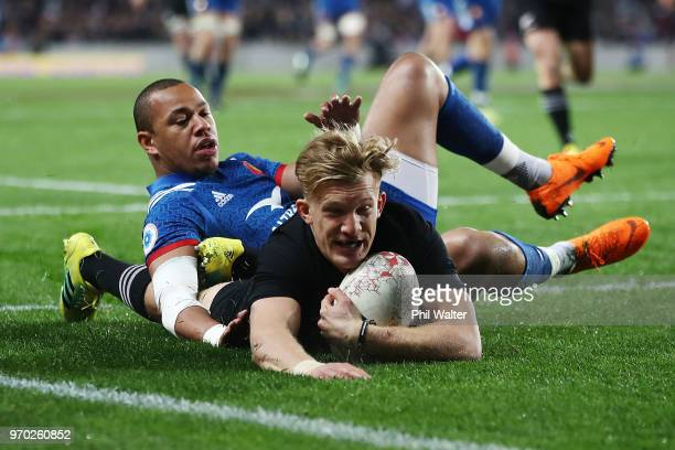 Damian McKenzie of the All Blacks scores a try during the International Test match between the New Zealand All Blacks and France at Eden Park on June...
