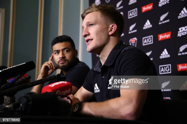 Damian McKenzie of the All Blacks speaks to media alongside Richie Mo'unga during a New Zealand All Blacks press conference on June 21 2018 in...