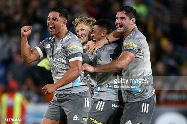 Damian McKenzie of the Chiefs celebrates defeating the HIghlanders with his team-mates during the round seven Super Rugby Aotearoa match between the...