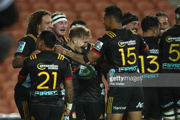 Damian McKenzie of the Chiefs celebrates his try during the round 15 Super Rugby match between the Chiefs and the Waratahs at FMG Stadium on May 26...