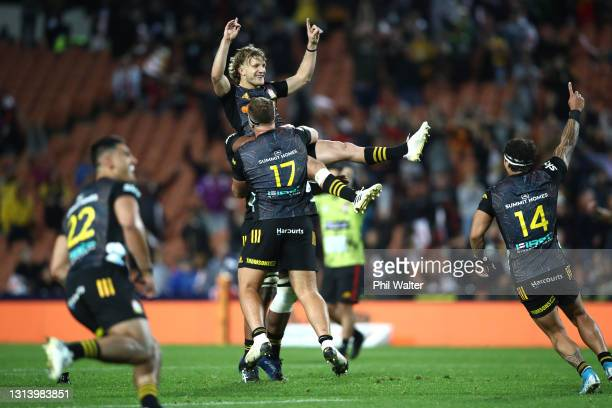 Damian McKenzie of the Chiefs celebrates kicking the match winning penalty during the round nine Super Rugby Aotearoa match between the Chiefs and...