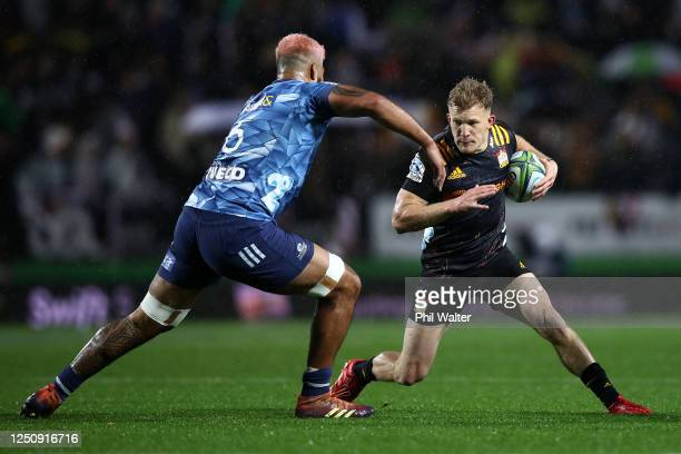Damian McKenzie of the Chiefs charges forward during the round 2 Super Rugby Aotearoa match between the Chiefs and the Blues at FMG Stadium Waikato...