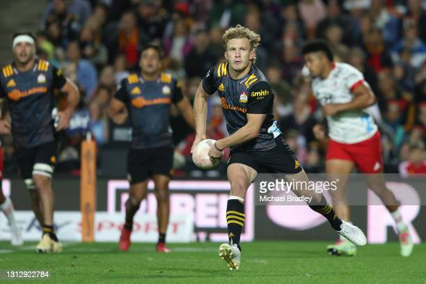 Damian McKenzie of the Chiefs looks to pass the ball during the round eight Super Rugby Aotearoa match between the Chiefs and the Crusaders at FMG...