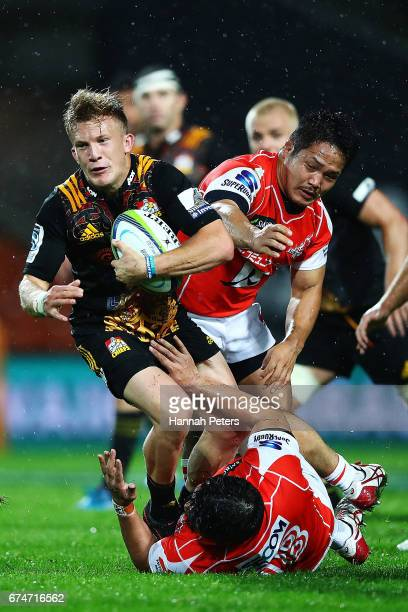 Damian McKenzie of the Chiefs makes a break during the round 10 Super Rugby match between the Chiefs and the Sunwolves at FMG Stadium on April 29...
