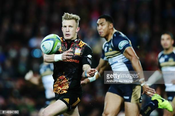 Damian McKenzie of the Chiefs makes a break during the round 17 Super Rugby match between the Chiefs and the Brumbies at Waikato Stadium on July 15...