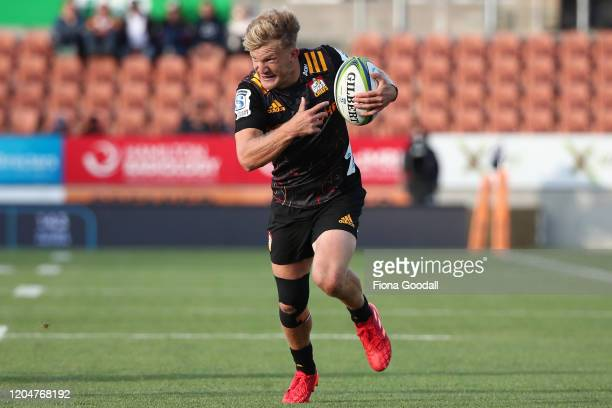 Damian McKenzie of the Chiefs makes a break during the round 2 Super Rugby match between the Chiefs and the Crusaders at FMG Stadium on February 08,...