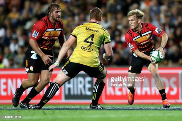 Damian McKenzie of the Chiefs makes a break during the round five Super Rugby match between the Chiefs and the Hurricanes at FMG Stadium Waikato on...