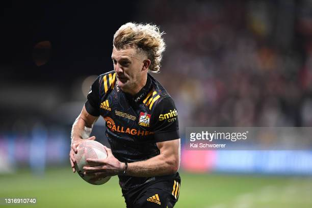 Damian McKenzie of the Chiefs makes a break during the Super Rugby Aotearoa Final match between the Crusaders and the Chiefs at Orangetheory Stadium,...