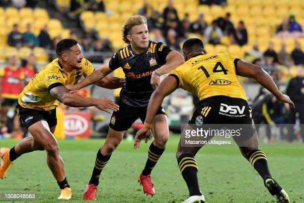 Damian McKenzie of the Chiefs passes the ball during the round four Super Rugby Aotearoa match between the Hurricanes and the Chiefs at Sky Stadium,...
