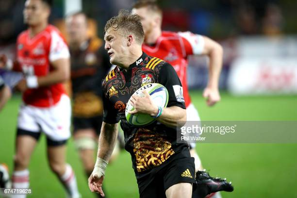 Damian McKenzie of the Chiefs runs away to score a try during the round 10 Super Rugby match between the Chiefs and the Sunwolves at FMG Stadium on...