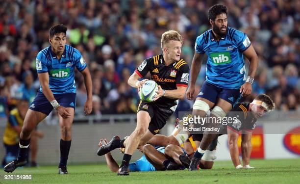 Damian McKenzie of the Chiefs runs the ball forward during the round two Super Rugby match between the Blues and the Chiefs at Eden Park on March 2...