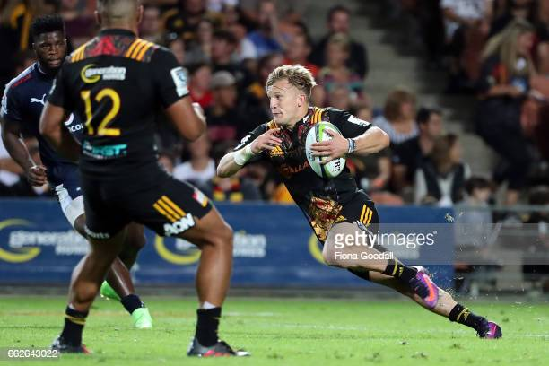 Damian McKenzie of the Chiefs steps during the round six Super Rugby match between the Chiefs and the Bulls at Waikato Stadium on April 1 2017 in...