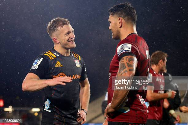 Damian McKenzie of the Chiefs talks with Codie Taylor of the Crusaders after the round 3 Super Rugby Aotearoa match between the Crusaders and the...