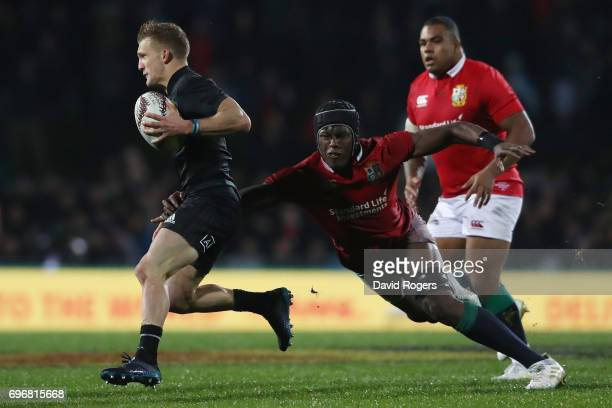 Damian McKenzie of the Maori All Blacks is tackled by Maro Itoje of the Lions during the 2017 British Irish Lions tour match between the Maori All...