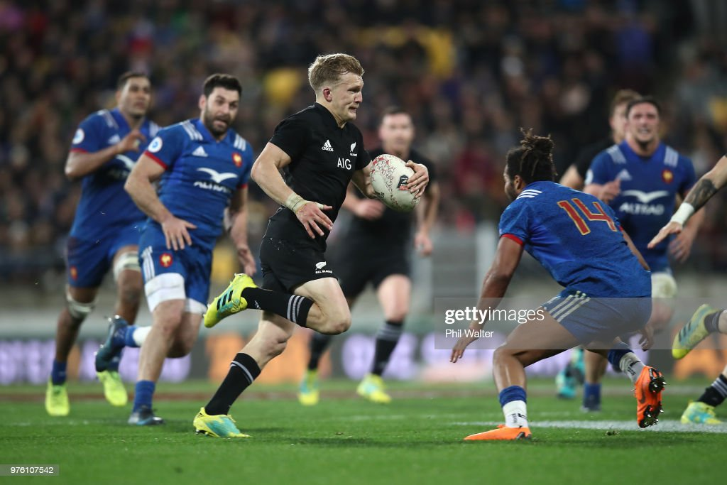 Damian McKenzie of the New Zealand All Blacks finds a gap during the International Test match between the New Zealand All Blacks and France at Westpac Stadium on June 16, 2018 in Wellington, New Zealand.