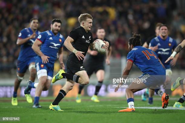 Damian McKenzie of the New Zealand All Blacks finds a gap during the International Test match between the New Zealand All Blacks and France at...
