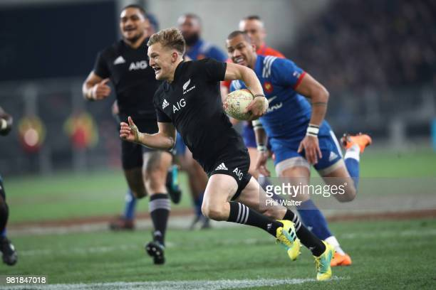 Damian McKenzie of the New Zealand All Blacks runs in for a try during the International Test match between the New Zealand All Blacks and France at...